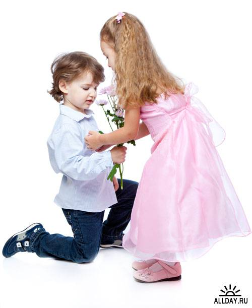 Stock Photo: Little boy and girl in love | Влюбленные мальчик и девочка