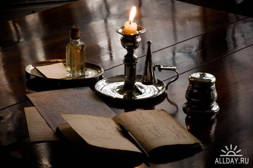 Stock Photo: A candle in old candlestick | Свеча в старинном подсвечнике
